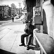 Man sitting along a street in San Francisco