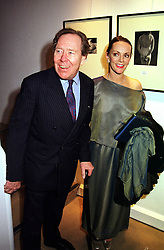 The EARL OF SNOWDON and photographer CHERYL FORGET COHEN (Mrs Kenneth Cohen) at a reception in London on 27th March 2000.OCH 34<br /> © Desmond O'Neill Features:- 020 8971 9600<br />    10 Victoria Mews, London.  SW18 3PY<br /> photos@donfeatures.com   www.donfeatures.com <br /> MINIMUM REPRODUCTION FEE AS AGREED.<br /> PHOTOGRAPH BY DOMINIC O'NEILL