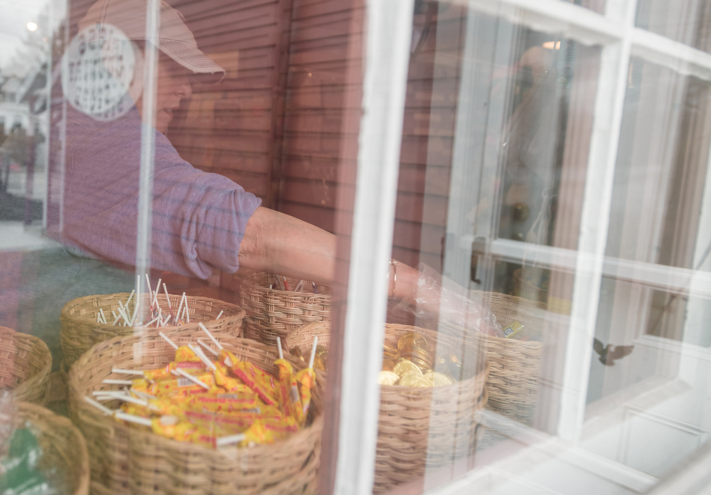 """CENTERVILLE - Janet Davis, co-owner of the 1856 Country Store, fills goodie bags with penny candy to deliver to families on Wednesday, March 25, 2020 Davis and her sister, Joanne Uchman decided to launch """"Operation Candy Drop"""" to lift spirits of  Cape Cod children during this time of social distance and quarantine."""