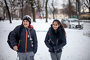 """Antonin Gabor (9) and Rachel Klemparova (9) after leaving school in a close by park. Antonin visits the 3rd class, Rachel the 4th. Both are visiting the """"Nadrazni"""" school in Ostrava where Roma and non Roma children are educated together."""