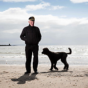 Former Celtic player and Lisbon Lion Bobby Lennox on the beach with his poodle Yanna at Saltcoats, near his home in the town. Bobby is wearing his cap that he received for playing in the international match versus England at Wembley in 1967 in which Scotland 3-2. Lennox scored for Scotland. Picture Robert Perry for The Times 13th April 2017
