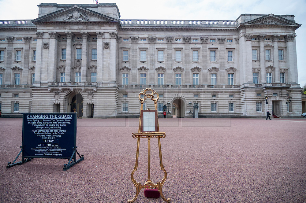 © Licensed to London News Pictures. 02/05/2015. London, UK. In keeping with tradition, the royal birth announcement of the Duke and Duchess of Cambridge's second child, a daughter, born at 8.34am, today, 2 May 2015, is posted on an easel outside Buckingham Palace.  The document is signed by the the delivery team at St Mary's Hospital in Paddington - led by Alan Farthing, the royal surgeon-gynaecologist.   Shortly earlier was the Changing The Guard ceremony, resulting in huge crowds outside the palace.  Photo credit : Stephen Chung/LNP