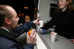 Woman serving hot drinks from a mobile soup kitchen in Nottingham,