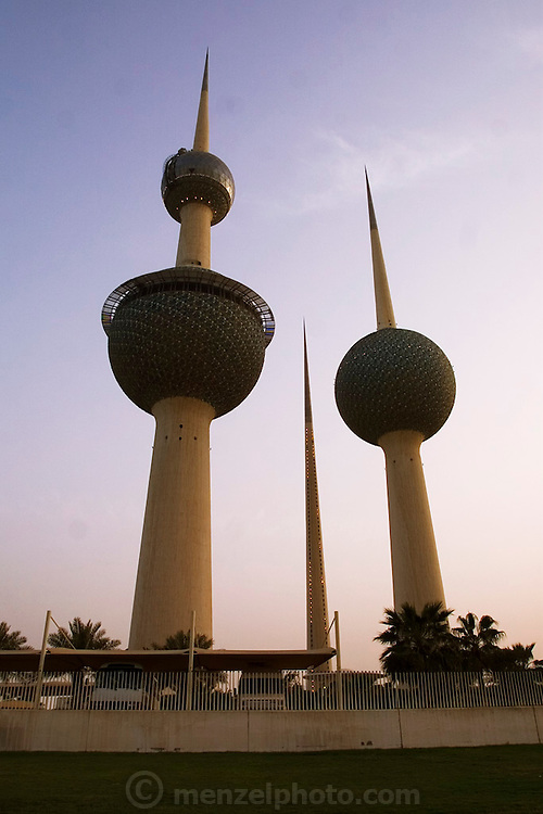 Kuwait Towers, Kuwait City, Kuwait. From the government website: One of Kuwait's most famous landmarks, the Kuwait Towers are situated on Arabian Gulf Street on a promontory to the east of the City centre in Dasman. The uppermost sphere of the largest tower (which is 187 meters high) has a revolving observation area and a restaurant with access by high speed lifts. The entrance fee is 350 fils per person, or free if lunch or dinner has been reserved. Cameras with zoom lens are forbidden. The middle tower contains 1 million gallons of water.? (Source information comes from: www.kuwait-info.com). (Supporting image from the project Hungry Planet: What the World Eats.).