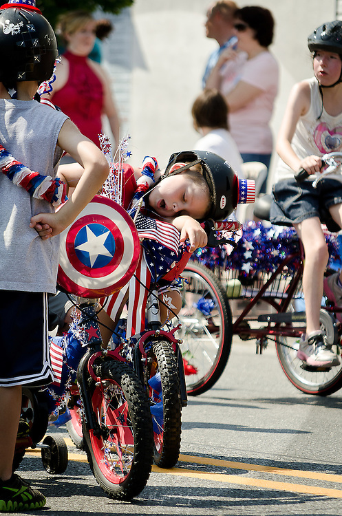 Not even half way into the Fourth of July parade and this youngster was already spent from the heat.
