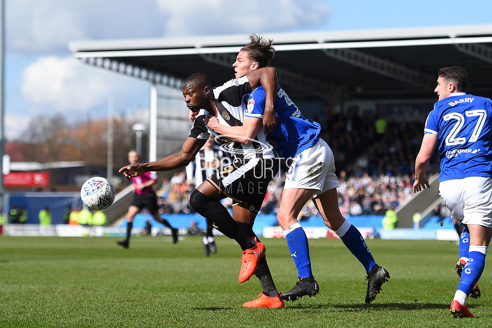 Notts County forward Shola Ameobi (9) battles with Chesterfield defender Sid Nelson (35) during the EFL Sky Bet League 2 match between Chesterfield and Notts County at the b2net stadium, Chesterfield, England on 25 March 2018. Picture by Jon Hobley.