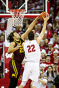 Center Reggie Lynch (22), left, reaches for a block during the first half of the University of Minnesota Men's Basketball game versus University of Wisconsin on March 5, 2017.