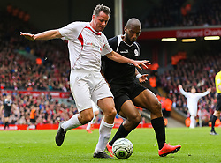 Jamie Carragher is closed down by Ryan Babel - Photo mandatory by-line: Dougie Allward/JMP - Mobile: 07966 386802 - 29/03/2015 - SPORT - Football - Liverpool - Anfield Stadium - Gerrard's Squad v Carragher's Squad - Liverpool FC All stars Game