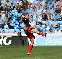 Photo: Mark Stephenson.<br />Coventry City v Queens Park Rangers. Coca Cola Championship. 07/04/2007. Coventry's Dale Adebola (L) tries to win the ball