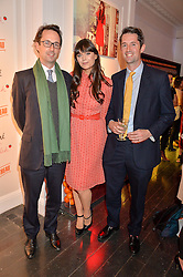 Left to right, MICHAEL PARSONS, LILAH PARSONS and DAVID PARSONS at the Cointreau launch for Yumi by Lilah Parsons SS/16 collection held at 15 Bateman Street, London on 1st December 2015
