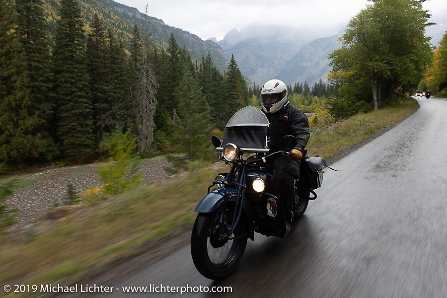 Steve Rinker rides through the rain on his1928 Indian Scout through Glacier National Park during the Motorcycle Cannonball coast to coast vintage run. Stage 12 (242 miles) from Great Falls to Kalispell, MT. Thursday September 20, 2018. Photography ©2018 Michael Lichter.