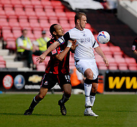 Photo: Leigh Quinnell.<br /> AFC Bournemouth v Swansea City. Coca Cola League 1. 14/04/2007. Swanseas Lee Trundle keeps the ball from Bournemouths Josh Gowling.
