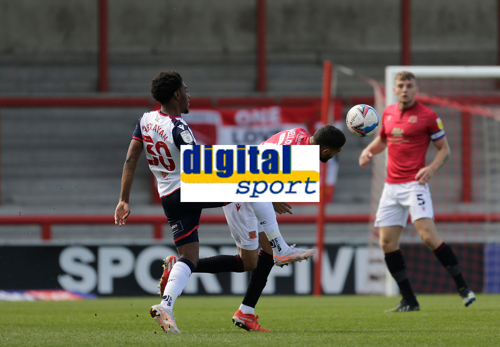 Football - 2020 / 2021 Sky Bet League Two - Morecambe vs. Bolton Wanderers<br /> <br /> Kelvin Mellor of Morecambe wins the ball against Oladapo Afolayan of Bolton Wanderers, at the Mazuma Stadium.<br /> <br /> COLORSPORT/ALAN MARTIN