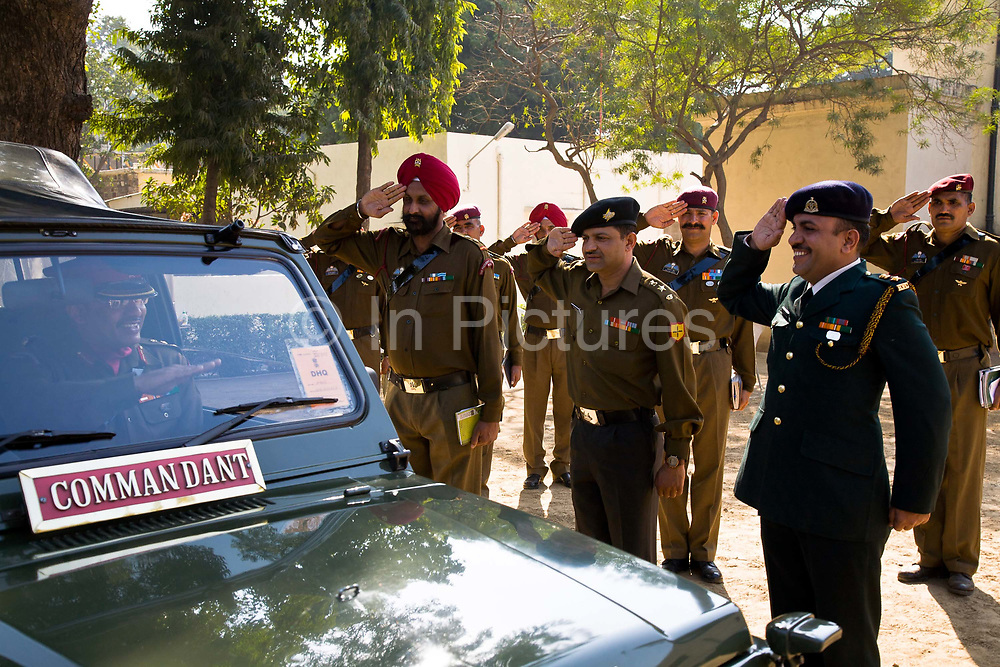 Commanding as well as non-commanding officers of The  Presidential Bodyguard regiment or PBG salute their Commander -in -Chief as he arrives to inspect their headquarters. The PBG is the Indian Army's preeminent regiment founded in 1773 during the British occupation, this handpicked unit began with a mere 50 men and today stands at 160 soldiers plus 50 support staff. It has a dual role, both as a ceremonial guard for the President of India, with all its finery at important state functions, as well as an elite operational unit for the Indian Army which has seen action in many battle fronts, in particular the on going disputed region of Kashmir, New Delhi, India. different soldiers take up their posts.