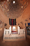 """Pictures of the beehive adobe buildings of Harran, south west Anatolia, Turkey.  Harran was a major ancient city in Upper Mesopotamia whose site is near the modern village of Altınbaşak, Turkey, 24 miles (44 kilometers) southeast of Şanlıurfa. The location is in a district of Şanlıurfa Province that is also named """"Harran"""". Harran is famous for its traditional 'beehive' adobe houses, constructed entirely without wood. The design of these makes them cool inside. 3 .<br /> <br /> If you prefer to buy from our ALAMY PHOTO LIBRARY  Collection visit : https://www.alamy.com/portfolio/paul-williams-funkystock/harran.html<br /> <br /> Visit our TURKEY PHOTO COLLECTIONS for more photos to download or buy as wall art prints https://funkystock.photoshelter.com/gallery-collection/3f-Pictures-of-Turkey-Turkey-Photos-Images-Fotos/C0000U.hJWkZxAbg ."""