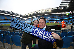 Fans hold up a half and half scarf
