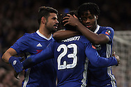 Michy Batshuayi © of Chelsea celebrates with Kurt Zouma of Chelsea (R) and Diego Costa (l) after he scores Chelsea's 4th goal. The Emirates FA Cup 4th round match, Chelsea v Brentford at Stamford Bridge in London on Saturday 28th January 2017.<br /> pic by Steffan Bowen, Andrew Orchard sports photography.