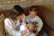 Mother age 35 with baby daughter and son age 5.  Burnsville Minnesota USA