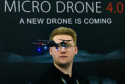 A stand holder demonstrates Micro Drone 4.0 the Toy Fair at Kensington Olympia in London, the UK's largest dedicated game and hobby exhibition featuring the hottest and most anticipated products for the year ahead. London, January 22 2019.