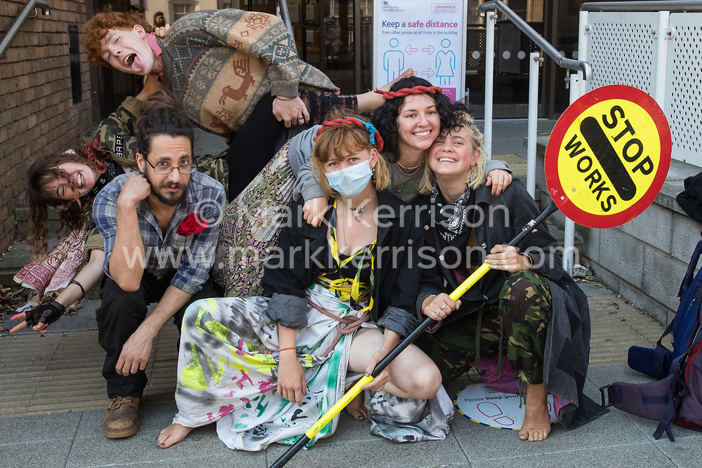 High Wycombe, UK. 10th August, 2020. Young environmental activists from HS2 Rebellion prepare to attend a hearing at High Wycombe Magistrates Court. The activists, who are predominantly teenage and who are opposed to the controversial HS2 high-speed rail link, had been arrested whilst standing on a bridge on a public footpath in Denham Country Park by police officers using powers under the Trade Union and Labour Relations Act 1992.