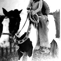 HS376-A     George W. Bush wearing a cowboy outfit as he sits on a pony, <br /> circa 1949-1950.<br /> Photo Credit:  George Bush Presidential Library
