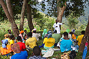 Andrew Kaggwa the community nurse from Bwindi community hospital gives nutritional advice to women from Kitahurira, the only Batwa tribe settlement in Mpungu district The mothers and children also receive vaccinations from the hospital nurse.  Bwindi Community Hospital provides different outreach clinics everyday for the surrounding area around Buhoma. The Mpungu district is on the edge of the Bwindi Impenetrable Forest, Western Uganda.