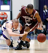 Montana's Anthony Johnson (23) battles for a loose ball against Weber State's Kyle Bullinger (3) during the second half of their NCAA, Big Sky Conference championship basketball game, Wednesday, March 10, 2010 in Ogden, Utah. Johnson scored a tournament record, 42 points and was the tournament's MVP in the Grizzlies 66-65 win.  (AP Photo/Colin E Braley)