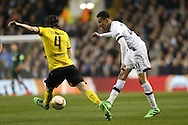 Dele Alli of Tottenham Hotspur passes the ball past Neven Subotic of Borussia Dortmund. UEFA Europa League round of 16, 2nd leg match, Tottenham Hotspur v Borussia Dortmund at White Hart Lane in London on Thursday 17th March 2016<br /> pic by John Patrick Fletcher, Andrew Orchard sports photography.