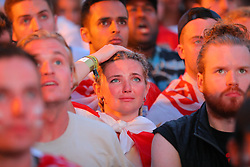 © Licensed to London News Pictures. 11/07/2018. London, UK. England fans in Flat Iron Square, London, react as Croatia score their second goal as they watch England play Croatia in extra time in the World Cup semi-final. Photo credit: Rob Pinney/LNP