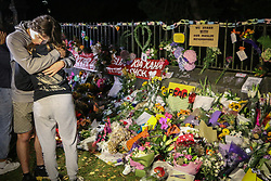 March 17, 2019 - Christchurch, Canterbury, New Zealand - People seen comforting themselves while paying respect to the victims of the Christchurch mosques shooting. Around 50 people has been reportedly killed a terrorist attack onn two Christchurch mosques. (Credit Image: © Adam Bradley/SOPA Images via ZUMA Wire)
