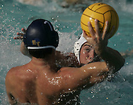 El Toro's Spencer White is defended by Sacred Heart's Tim Norton during El Toro's 12-11 overtime victory over Sacred Heart Prep in the championship match of the Villa Park Tournament Saturday.