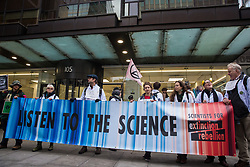 London, UK. 22 November, 2019. Climate activists from Scientists for XR gather outside the headquarters of the Labour Party during a demonstration intended to communicate the science relating to the climate and ecological emergency. Activists were dressed in labcoats to represent the 1600 scientists worldwide who have signed the Scientists Declaration in support of non-violent direct action against government inaction against the climate and ecological emergency.