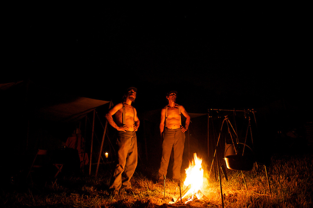 Father and son, Gary Reigle Sr. and Gary Jr. light a campfire in the Union camp on the second night of the 149th Gettysburg Reenactment in Gettysburg, Pennsylvania.