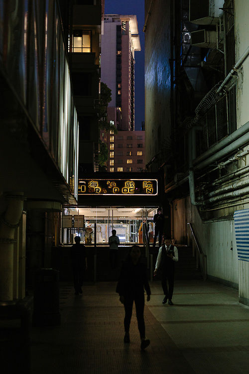 People are seen in an alley in Tsim Sha Tsui, Kowloon, Hong Kong, China, on September 25, 2019.