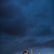 Suleymaniye Mosque on Istanbul's skyline at night. Dedicated to Suleiman the Magnificent (or Suleiman I), the longest-reigning Ottoman Sultan (1520-1566), Süleymaniye Mosque stands prominently on Istanbul's Third Hill and is considered the city's most important mosque. It was completed in 1558.