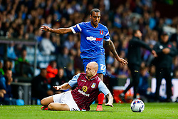 Alan Hutton of Aston Villa is brought down by Jay Simpson of Leyton Orient - Photo mandatory by-line: Rogan Thomson/JMP - 07966 386802 - 27/08/2014 - SPORT - FOOTBALL - Villa Park, Birmingham - Aston Villa v Leyton Orient - Capital One Cup Round 2.