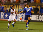 CHATTANOOGA, TN - AUGUST 19:  Forward Christen Press #23 of the United States traps the ball behind defender Diana Saenz #5 of Costa Rica during the friendly match at Finley Stadium on August 19, 2015 in Chattanooga, Tennessee.  (Photo by Mike Zarrilli/Getty Images)