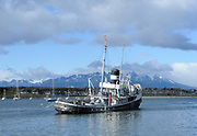 A dilapidated and abandoned tug boat, the Saint Christopher,  in the harbour at Ushuaia.  Ushuaia, Tierra del Fuego, Argentina. 13Feb16
