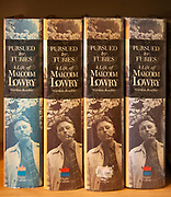 Pursued by Furies, a Life of Malcolm Lowry by Gordon Bowker, four hardback books in a row