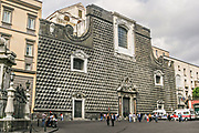 The Church of Gesu Nuovoin Naples, southern Italy. The Church of Gesu Nuovo was originally a palace built in 1470 for Roberto Sanseverino, Prince of Salerno. The unusual building is faced with with rustic ashlar diamond projections.
