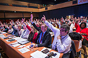 Len McCluskey, General Secretary of Unite with other Unite dlegates voting at TUC Congress, 2013. Bournmouth.