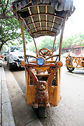 LIUZHOU, CHINA - MAY 19: (CHINA OUT) <br /> <br /> Wooden Three-wheeled Vehicle<br /> <br /> Wei Guirongs first home-made three-wheeled vehicle is seen on May 19, 2014 in Liuzhou, Guangxi Province of China. Wei Guirong, 66, has made three wooden three-wheeled vehicles for grandchildren, and the vehicles are made entirely from wood, apart from the engine, wheels and some electronic parts. He was in charge of maintaining agricultural machinery when he was younger. <br /> ©Exclusivepix