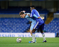 Manchester City's Brandon Barker holds off the challenge from Chelsea's Ola Aina<br /> <br /> Photographer Ashley Western/CameraSport<br /> <br /> Football - The FA Youth Cup Second Leg - Chelsea U18's v Manchester City U18's - Monday 27th April 2015 - Stamford Bridge - London<br /> <br /> © CameraSport - 43 Linden Ave. Countesthorpe. Leicester. England. LE8 5PG - Tel: +44 (0) 116 277 4147 - admin@camerasport.com - www.camerasport.com