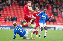 AberdeenÕs Greg Stewart jumps over Rangers Joe Worrall during the William Hill Scottish Cup quarter final match at Pittodrie Stadium, Aberdeen.