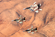 A formation of 2 F-16 and one F-15 Israeli Air Force fighter jets flying over the Judea mountains Dead sea area, Israel