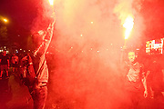 French nationals use torches to celebrate the victory of France at the World Cup Final. Champs-Élysées, Paris, France.