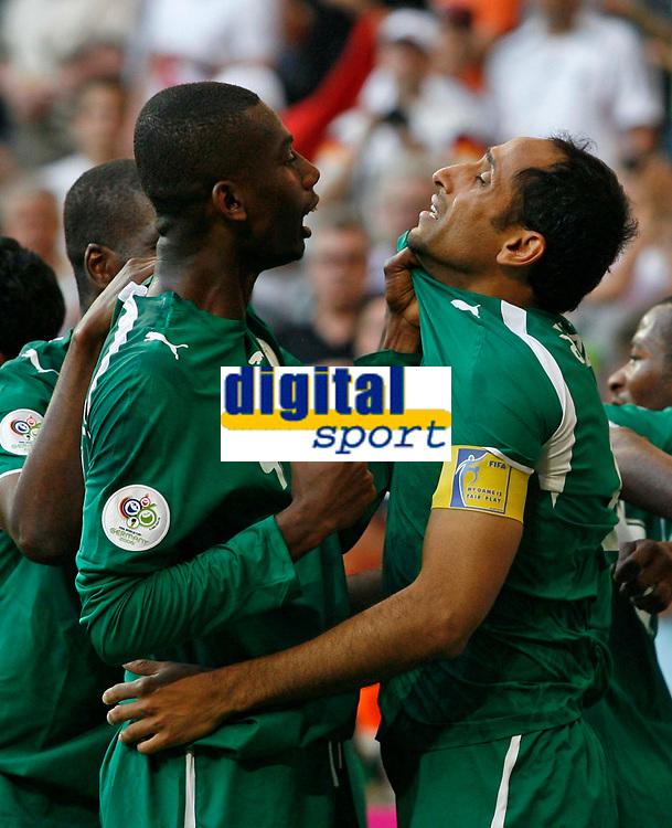 Photo: Glyn Thomas.<br />Tunisia v Saudi Arabia. Group H, FIFA World Cup 2006. 14/06/2006.<br /> Saudi Arabia's Sami Al Jaber (R) is congratulated by teammate Hamad Al Montashari after scoring his team's second goal.