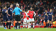 Arsenal's Alexandre Lacazette looks on as the referee, Martin Atkinson waits for a decision from VAR on the goal that eventually stood during the Premier League match at the Emirates Stadium, London. Picture date: 7th March 2020. Picture credit should read: Paul Terry/Sportimage