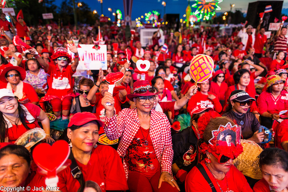 10 MAY 2014 - BANGKOK, THAILAND:  Thousands of Thai Red Shirts, members of the United Front for Democracy Against Dictatorship (UDD), members of the ruling Pheu Thai party and supporters of the government of ousted Prime Minister Yingluck Shinawatra are rallying on Aksa Road in the Bangkok suburbs. The government was ousted by a court ruling earlier in the week that deposed Yingluck because the judges said she acted unconstitutionally in a personnel matter early in her administration. Thailand now has no functioning government. Red Shirt leaders said at the rally Saturday that any attempt to impose an unelected government on Thailand could spark a civil war. This is the third consecutive popularly elected UDD supported government ousted by the courts in less than 10 years.   PHOTO BY JACK KURTZ