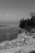 Sunset at the Grand Marais Harbor, Grand Marais, Minnesota, USA, on a cold January evening.